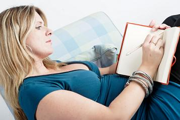 woman with a weight loss diary