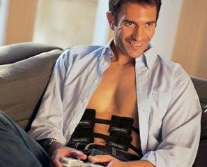 man using an ab belt while playing console games