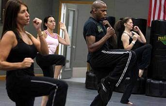 adults performing cardio kickboxing