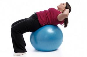 woman losing weight with balance ball